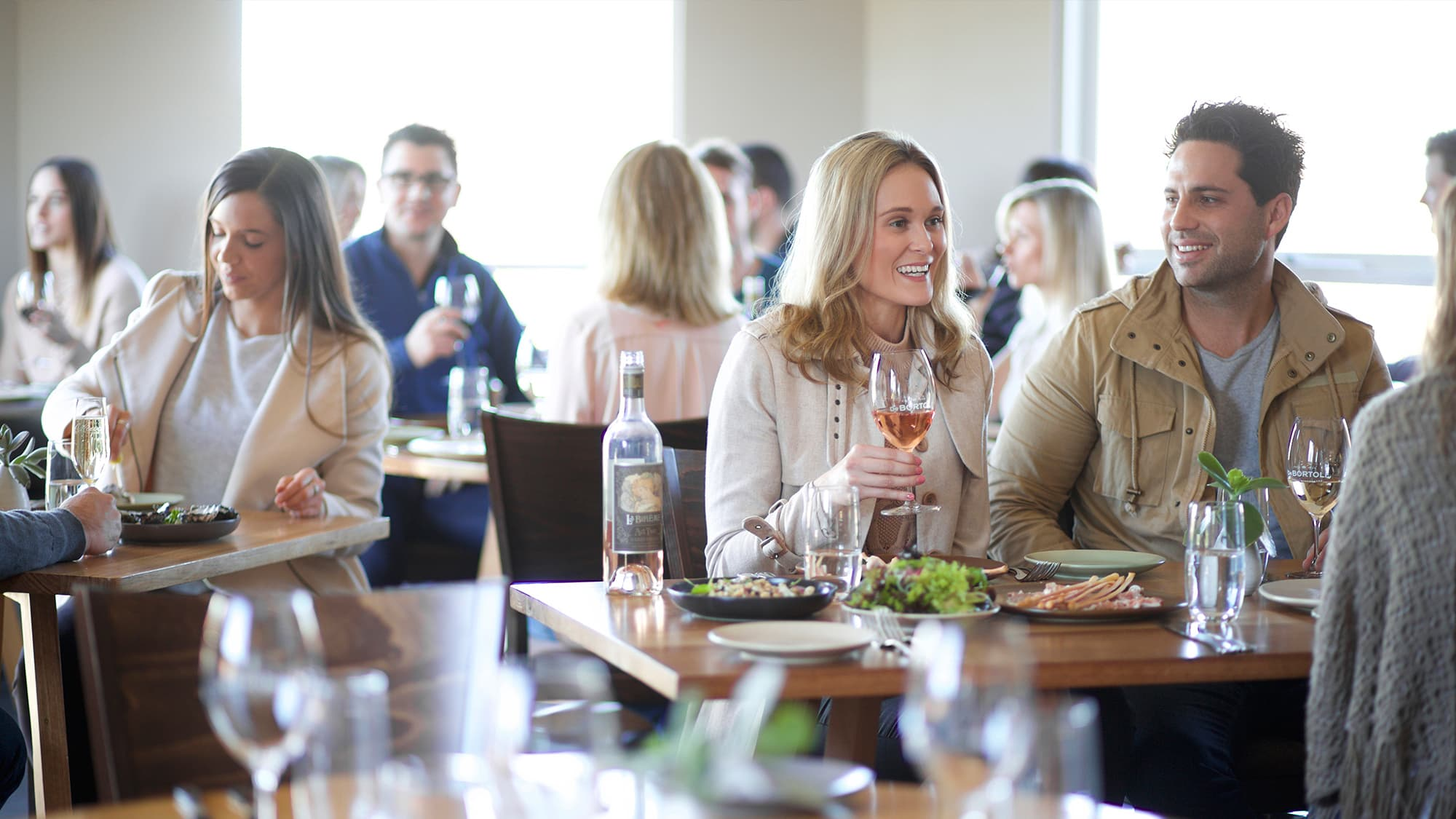 Diners enjoying food and wine at Locale Restaurant at De Bortoli Yarra Valley Estate
